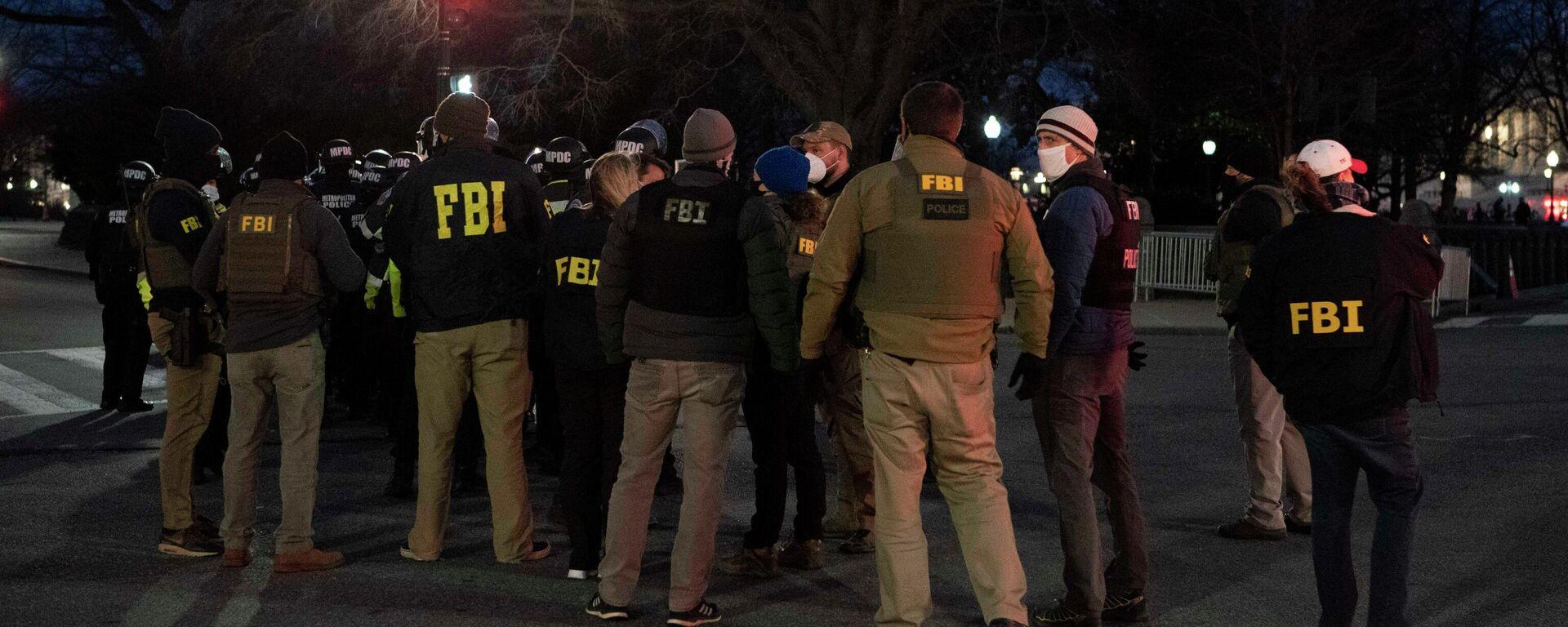 FBI-Beamte während Protesten in Washington am 6. Januar 2021 - SNA, 1920, 08.01.2021