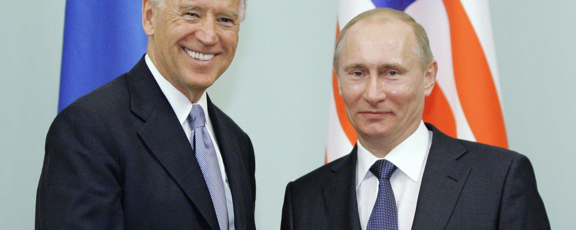 Joe Biden (l.) und Wladimir Putin in Moskau (Archivbild) - SNA, 1920, 18.03.2021