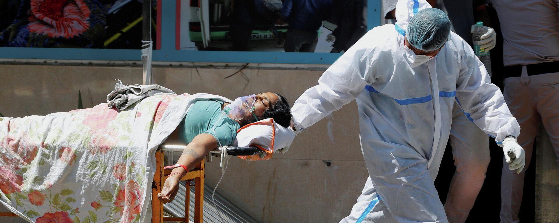 Akuter Sauerstoffmangel in Indien: Frau wird in ein Krankenhaus eingeliefert, New Delhi. - SNA, 1920, 26.04.2021