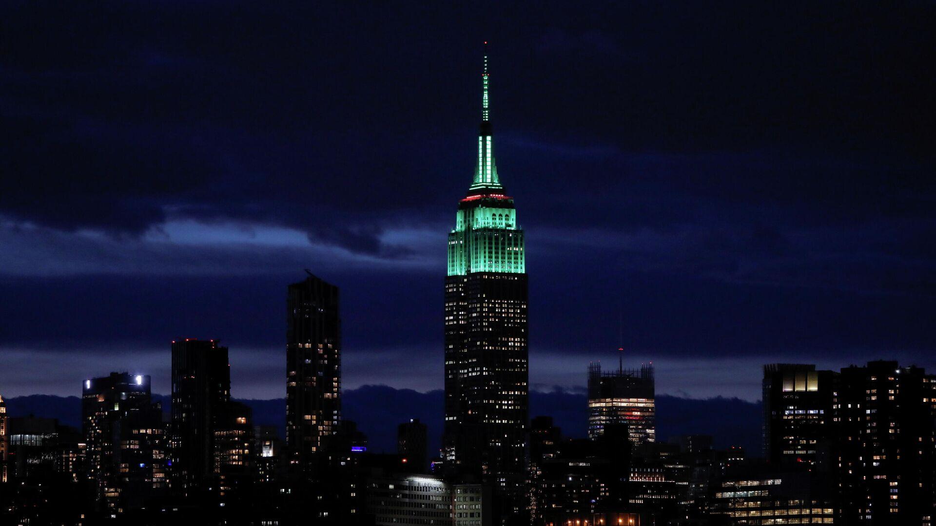 Das Empire State Building ist grün beleuchtet, um den Tag der Erde zu feiern. Manhattan, USA, 22. April 2021. - SNA, 1920, 28.04.2021