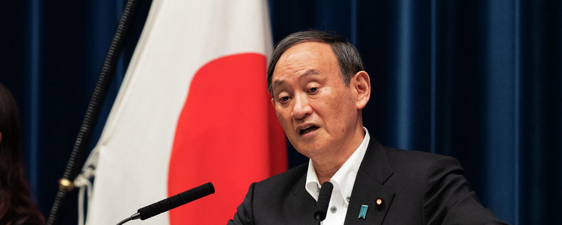 Der japanische Premierminister Yoshihide Suga bei einer Pressekonferenz am 07.05.21 - SNA, 1920, 10.05.2021