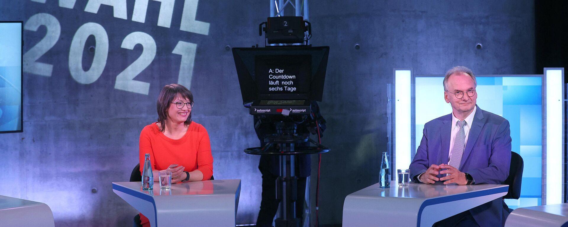Amtierender Ministerpräsident von Sachsen-Anhalt, Reiner Haseloff (CDU), und SPD-Spitzenkandidatin für die Landtagswahl Katja Pähle in einer Fernsehdebatte im MDR. - SNA, 1920, 05.06.2021