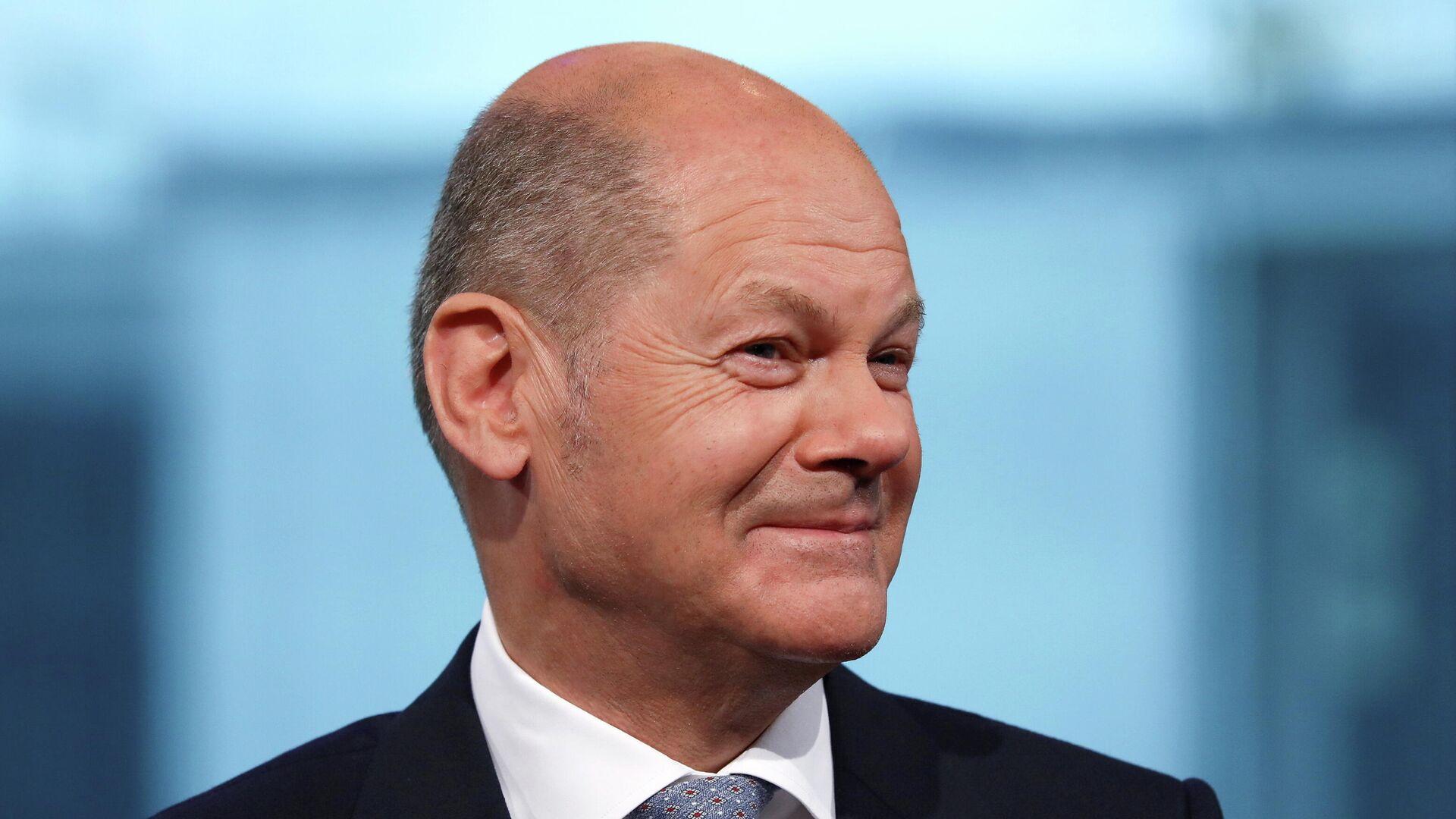 Bundesfinanzminister Olaf Scholz von der Sozialdemokratischen Partei (SPD) nimmt am 26. Juni 2021 in Berlin an einer Fernsehdebatte teil. - SNA, 1920, 14.07.2021