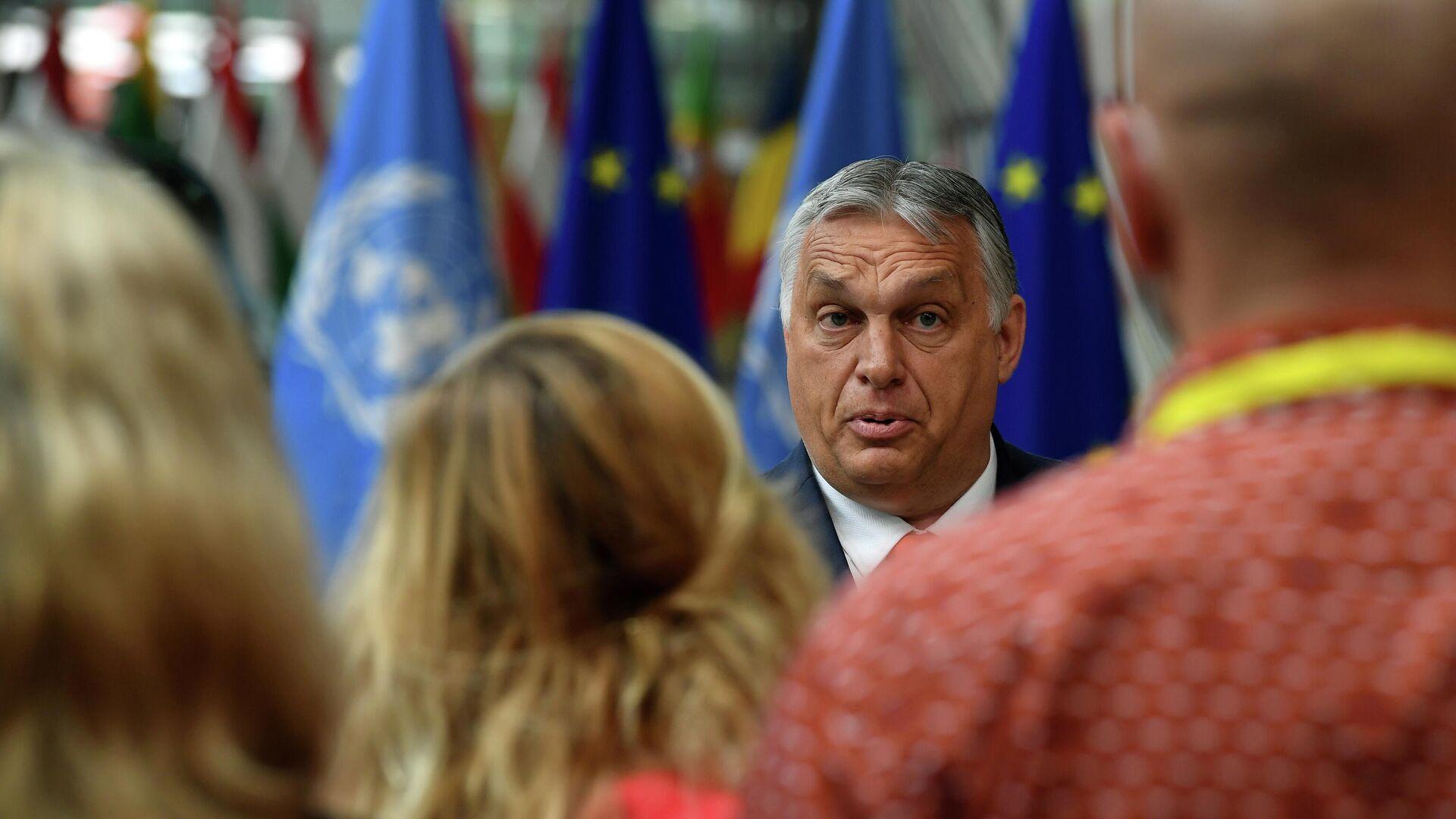 Ungarns Premierminister Viktor Orban spricht bei seiner Ankunft am ersten Tag des EU-Gipfels im Gebäude des Europäischen Rates in Brüssel am 24. Juni 2021 vor den Medien. - SNA, 1920, 06.07.2021