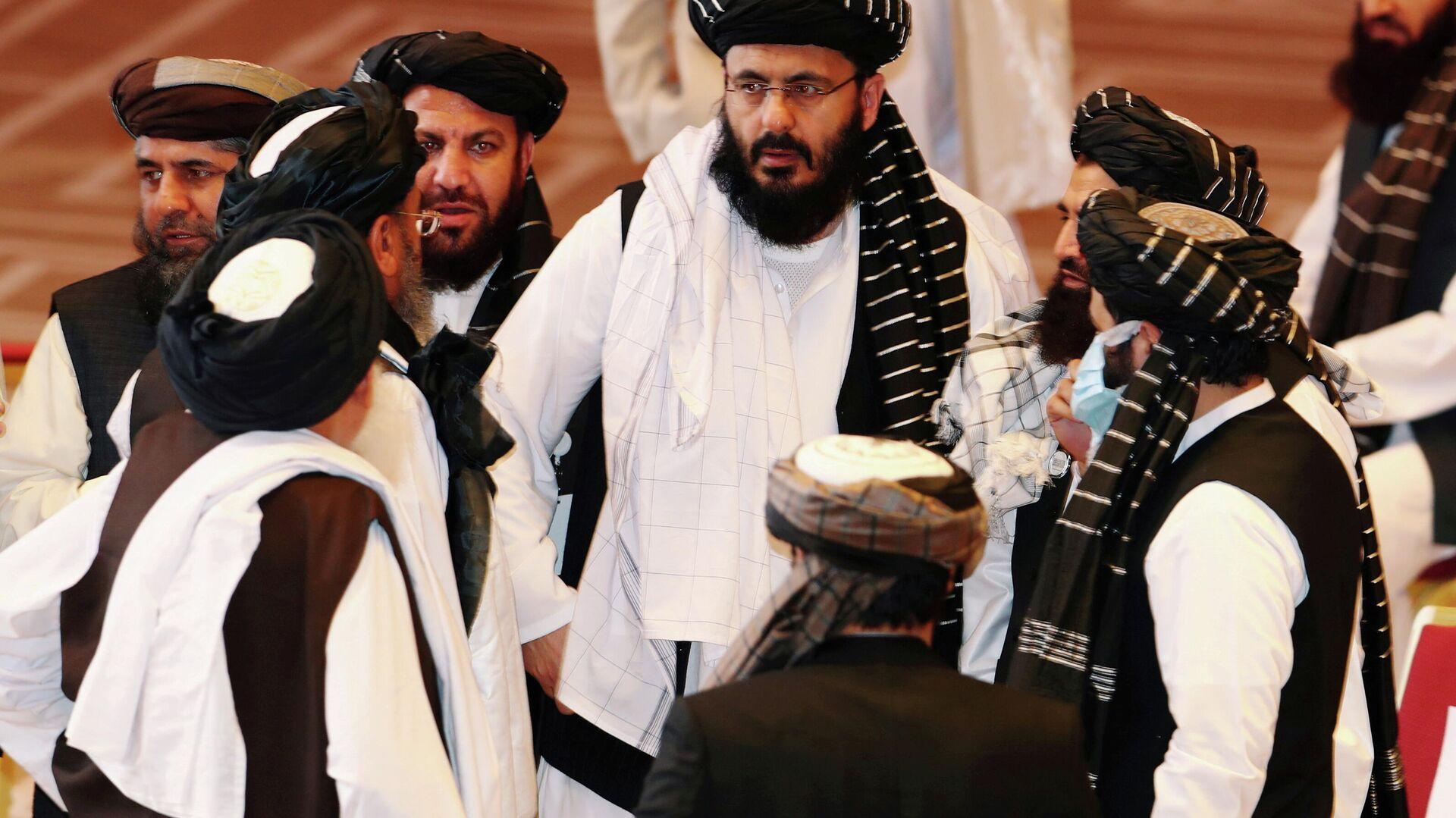 Vertreter der afghanischen Regierung und der Taliban-Bewegung verhandeln in Katar, Doha (Archivbild) - SNA, 1920, 06.07.2021