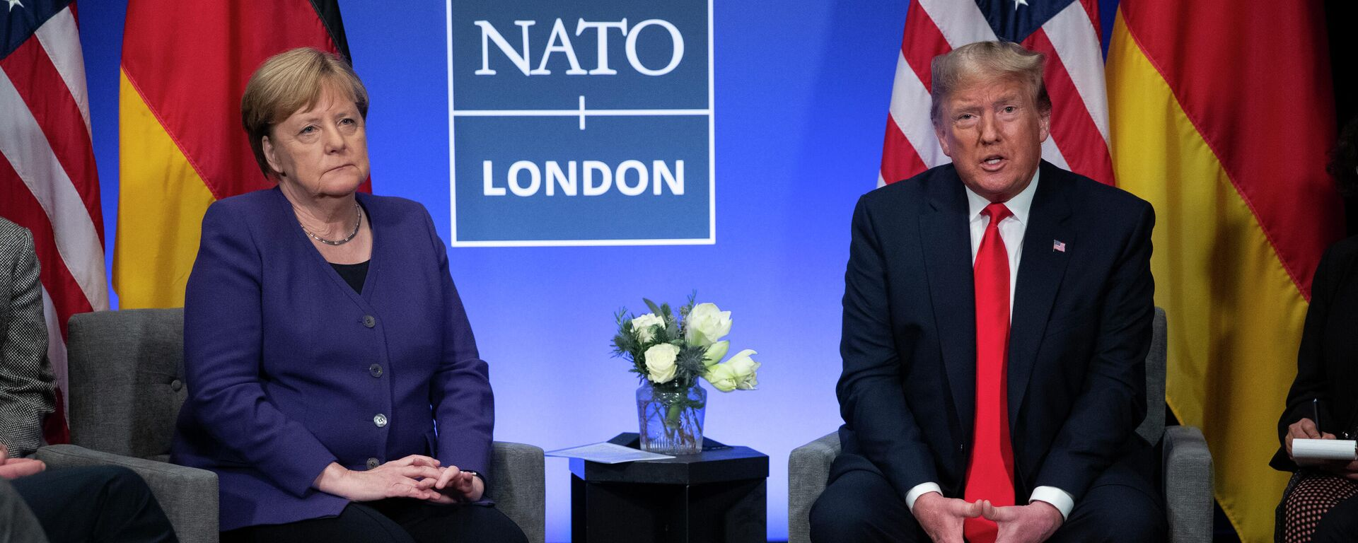 Die deutsche Bundeskanzlerin Angela Merkel und der damalige US-Präsident Donald Trump beim Nato-Gipfel 2019 - SNA, 1920, 15.07.2021