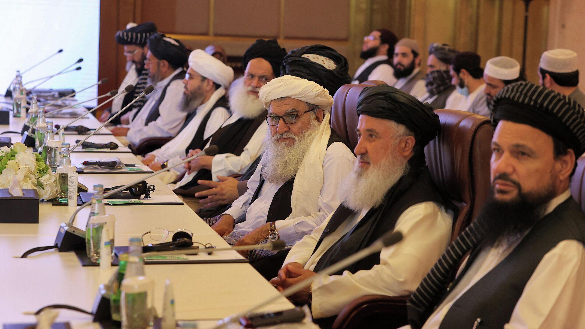 Mitglieder einer Taliban-Delegation bei Friedensgesprächen mit der afghanischen Regierung. Doha, 18. Juli 2021 - SNA, 1920, 23.07.2021