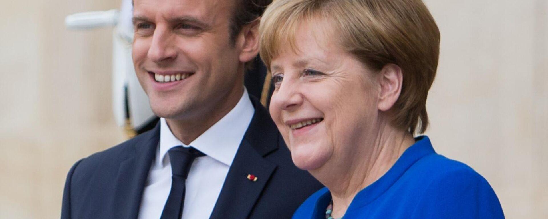 Bundeskanzlerin Angela Merkel und Frankreichs Präsident Emmanuel Macron (Archivbild) - SNA, 1920, 30.08.2021