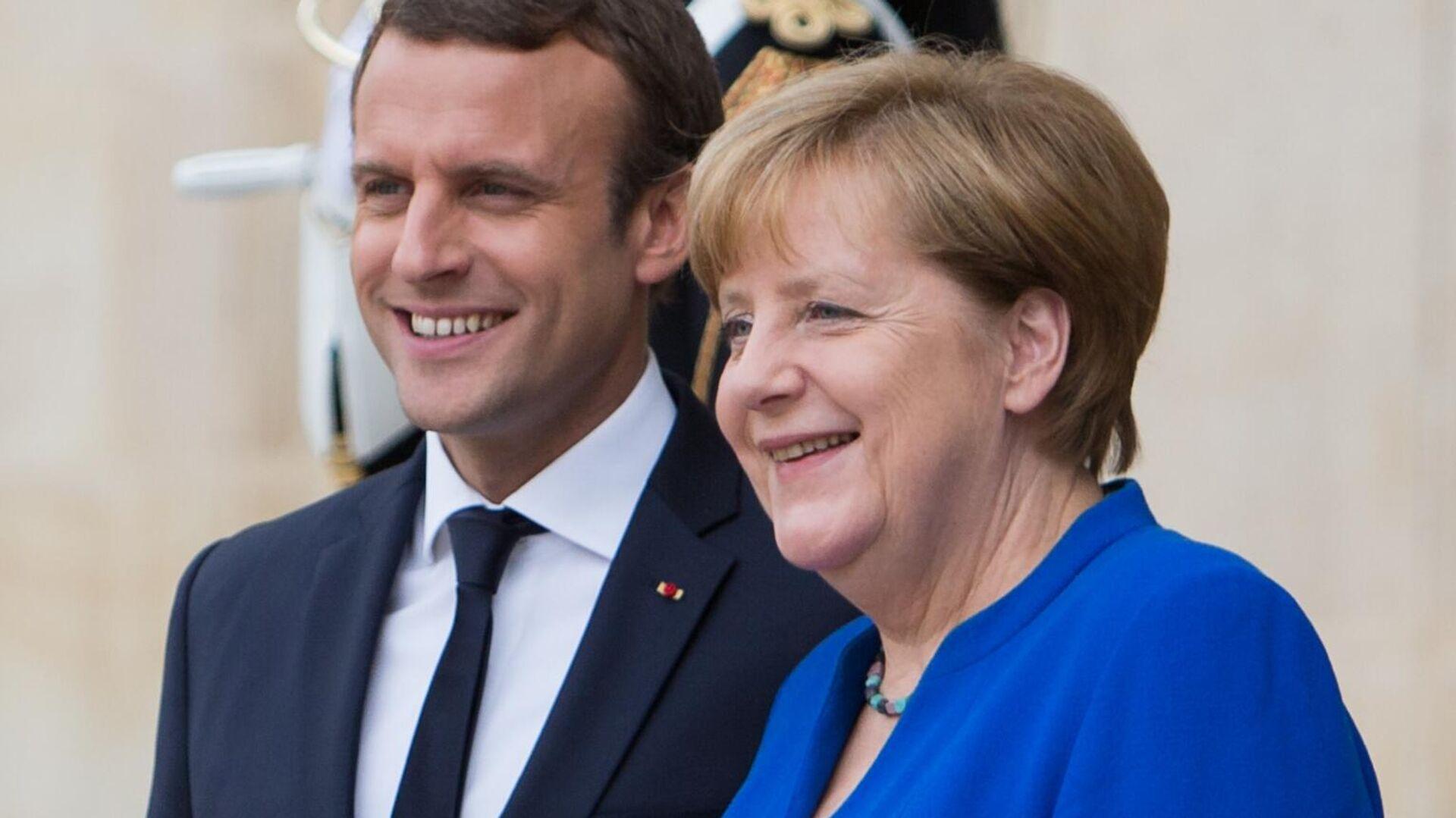 Bundeskanzlerin Angela Merkel und Frankreichs Präsident Emmanuel Macron (Archivbild) - SNA, 1920, 16.09.2021