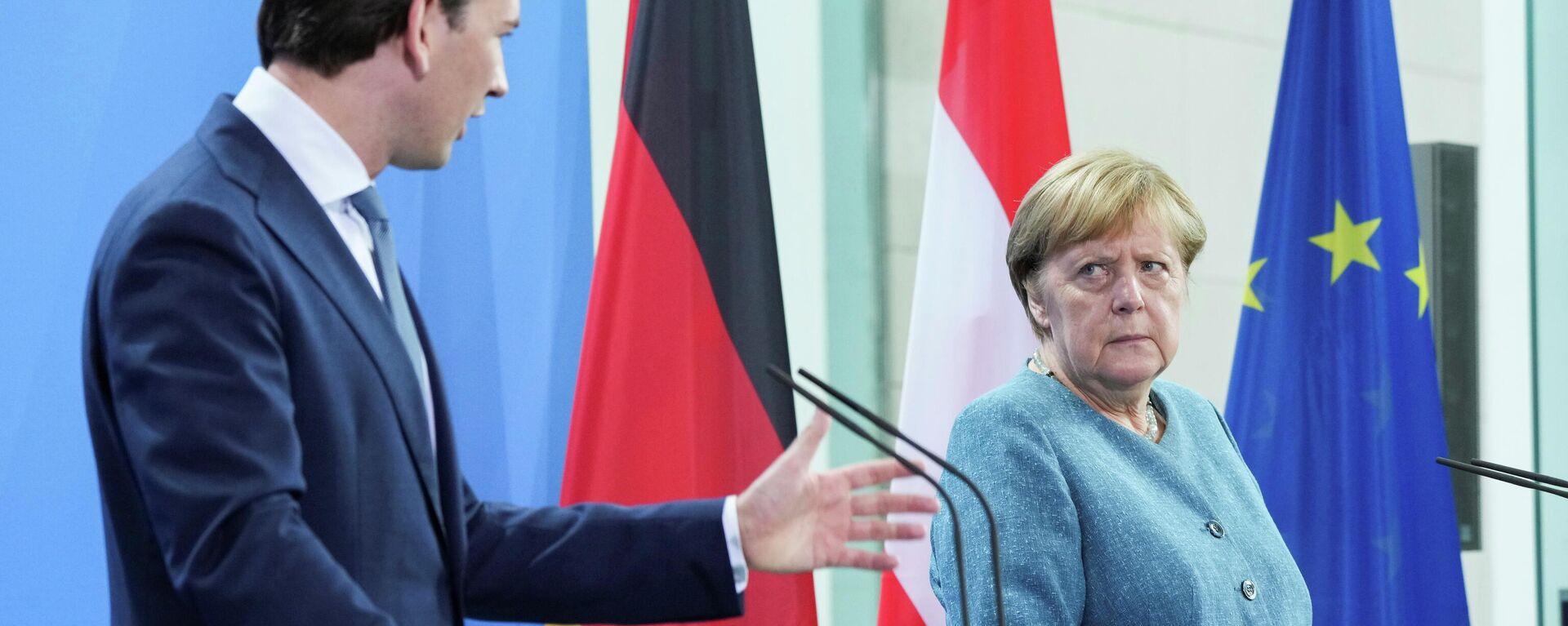 Bundeskanzlerin Angela Merkel und Österreichs Bundeskanzler Sebastian Kurz auf einer Pressekonferenz vor Gesprächen in Berlin, den 31. August. - SNA, 1920, 31.08.2021
