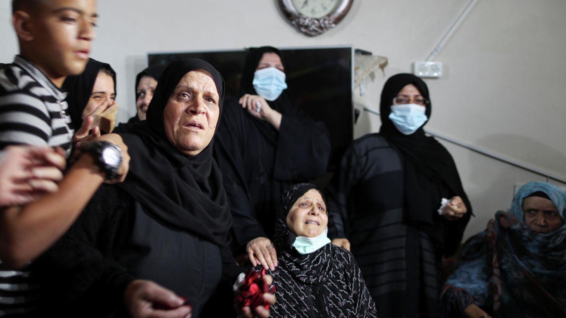 Verwandte von Ahmed Saleh, der durch israelische Truppen im Gazastreifen getötet wurde. - SNA, 1920, 03.09.2021