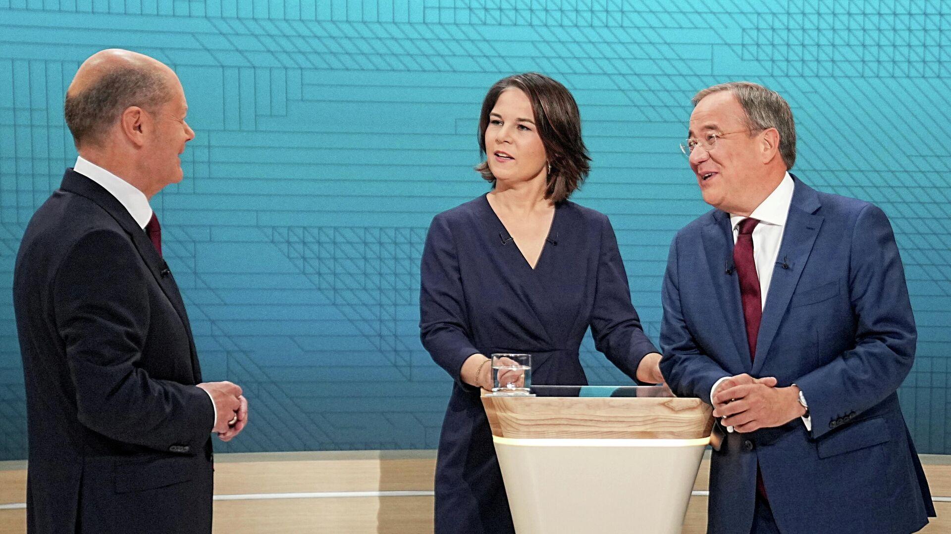 Kanzlerkandidatin Annalena Baerbock (Grüne) und Kanzlerkandidaten Armin Laschet (Union) und Olaf Scholz (SPD) beim Triell, den 12. September. - SNA, 1920, 18.09.2021