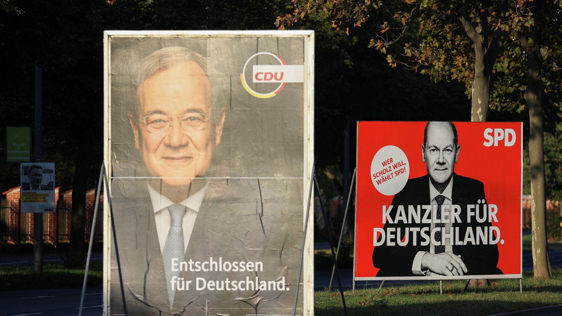 Wahlplakate der deutschen Kanzlerkanzlerkandidaten, des nordrhein-westfälischen Ministerpräsidenten und CDU-Chefs Armin Laschet und des Bundesfinanzministers der Sozialdemokratischen Partei (SPD) Olaf Scholz.  - SNA, 1920, 16.09.2021