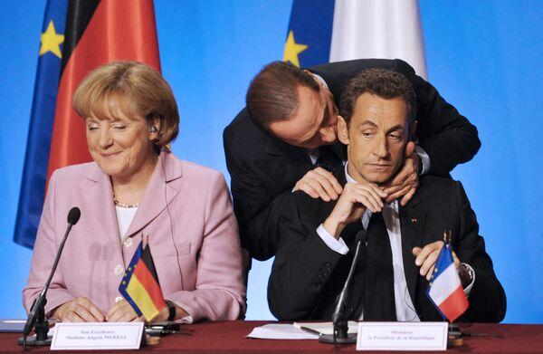 Am 16. Januar 2021 wurde auf einem CDU-Parteitag der 59-jährige Armin Laschet zum neuen Parteichef gewählt.Foto: Bundeskanzlerin Angela Merkel, Frankreichs Präsident Nicolas Sarkozy und der italienische Premierminister Silvio Berlusconi während eines Arbeitstreffens in Paris, 2008. - SNA