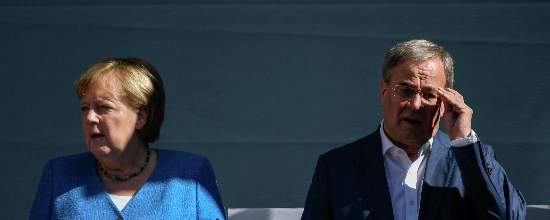 Unions-Kanzlerkandidat Armin Laschet und Bundeskanzlerin Angela Merkel in einem Wahlkampf-Schlussspurt in Aachen  - SNA, 1920, 25.09.2021