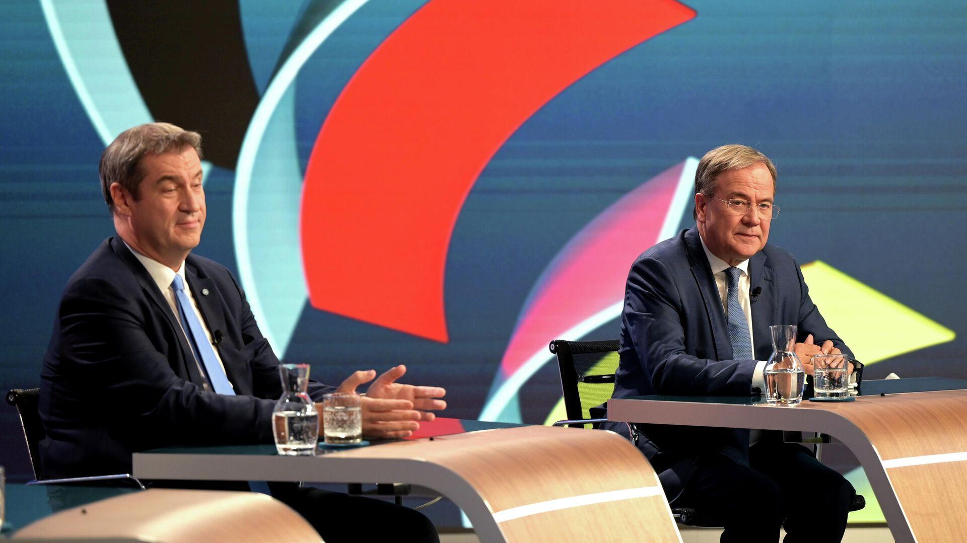 CSU-Vorsitzender Markus Söder und CDU-Chef Armin Laschet im TV-Talk am 26. September 2021 - SNA, 1920, 27.09.2021
