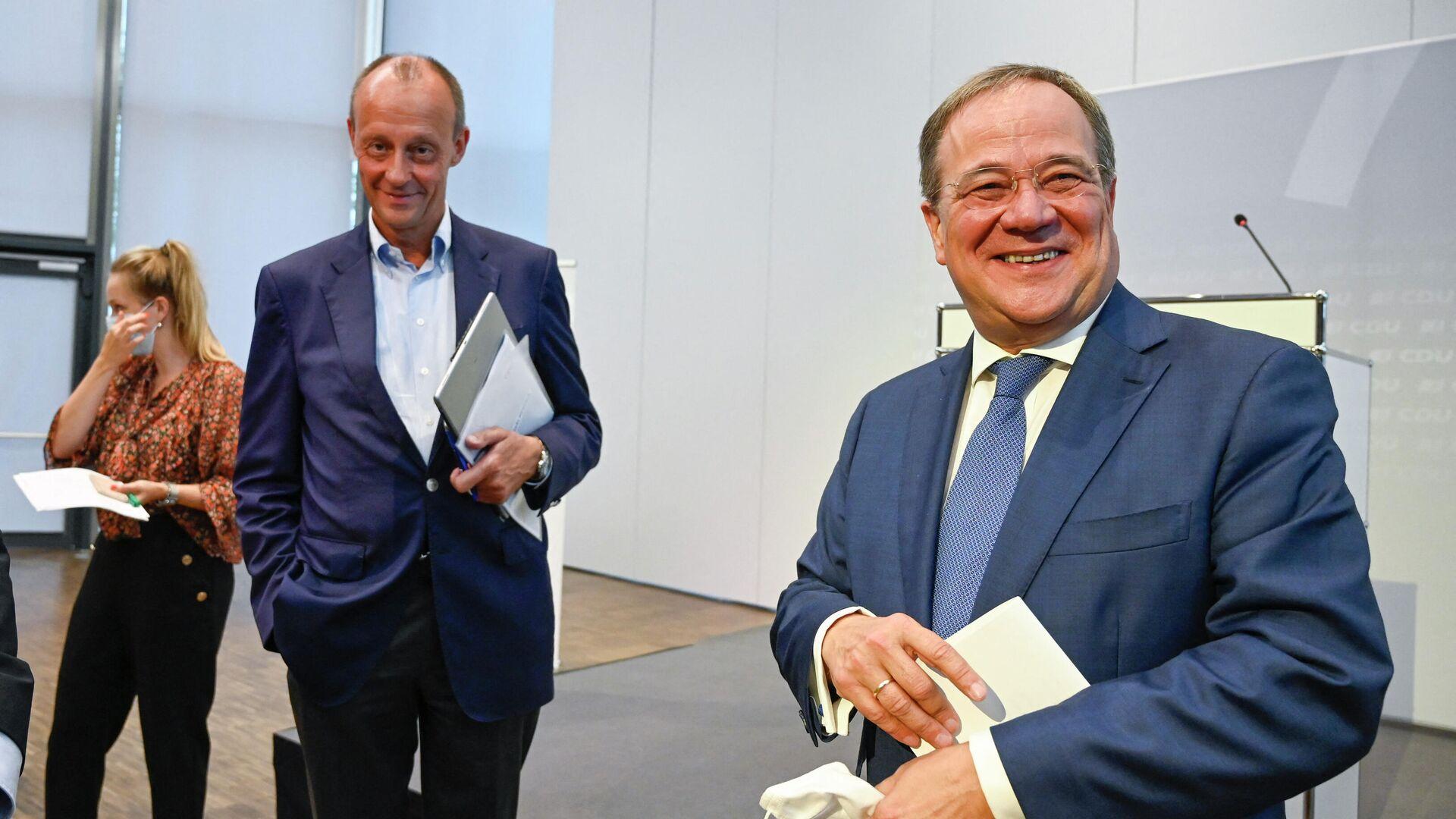 Der nordrhein-westfälische Ministerpräsident Armin Laschet, CDU-Vorsitzender und Kanzlerkandidat, und der CDU-Politiker Friedrich Merz  - SNA, 1920, 08.10.2021