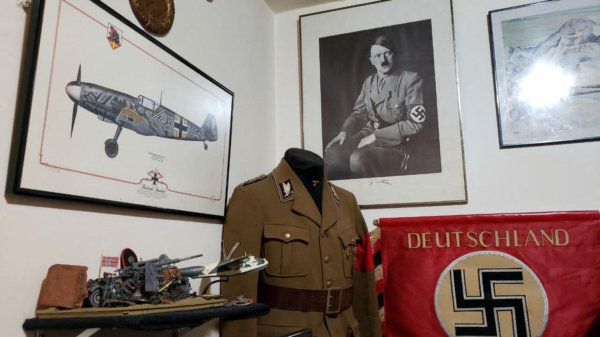 Ein Teil der Sammlung von Nazi-Gegenständen , die im Haus eines mutmaßlichen Pädophilen in Rio de Janeiro gefunden wurde - SNA, 1920, 08.10.2021