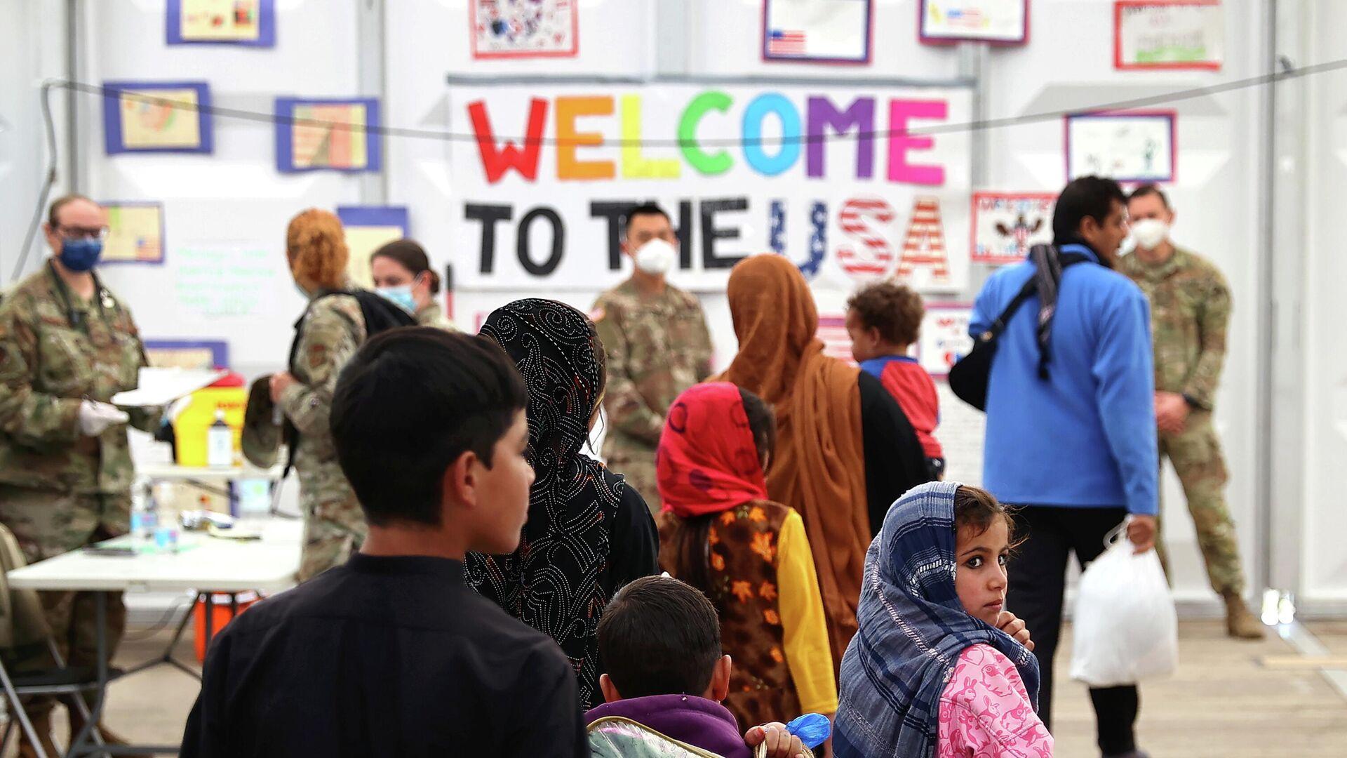 Evakuierte aus Afghanistan versammeln sich am 9. Oktober auf dem US-Luftwaffenstützpunkt Ramstein - SNA, 1920, 10.10.2021
